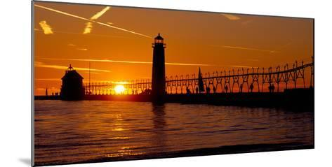 Grand Haven Lighthouse at Sunset, Grand Haven, Michigan, USA--Mounted Photographic Print