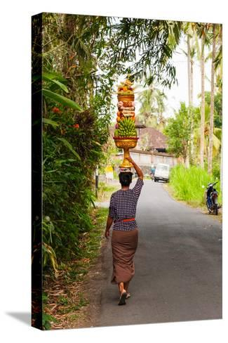Woman Carrying Offering to Temple, Pejeng Kaja, Tampaksiring, Bali, Indonesia--Stretched Canvas Print
