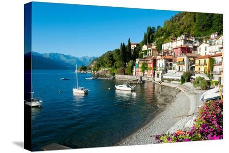 Houses at Waterfront with Boats on Lake Como, Varenna, Lombardy, Italy--Stretched Canvas Print