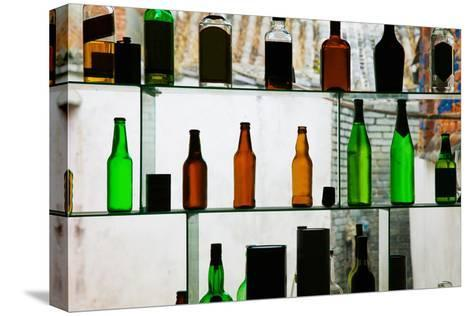 Bottles Displayed at Foreigner Bar, Old Town, Dali, Yunnan Province, China--Stretched Canvas Print