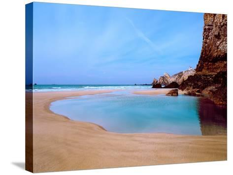 Beach with a Lighthouse in the Background, Pointe Du Toulinguet, Crozon, Finistere, Brittany--Stretched Canvas Print
