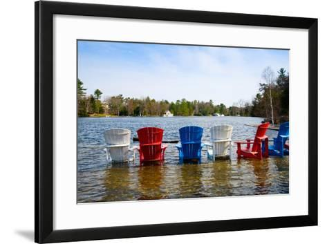 Adirondack Chairs Partially Submerged in the Lake Muskoka, Ontario, Canada--Framed Art Print