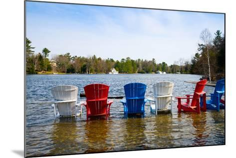 Adirondack Chairs Partially Submerged in the Lake Muskoka, Ontario, Canada--Mounted Photographic Print