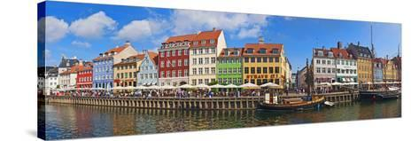 Buildings Along a Canal with Boats, Nyhavn, Copenhagen, Denmark--Stretched Canvas Print