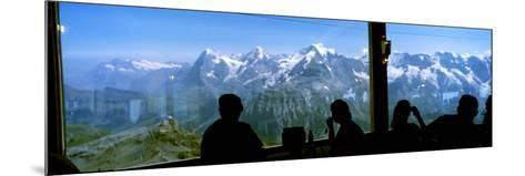 Tourists at Schilthorn 007 Restaurant with Mt Eiger Mt Monch Mt Jungfrau in the Background--Mounted Photographic Print