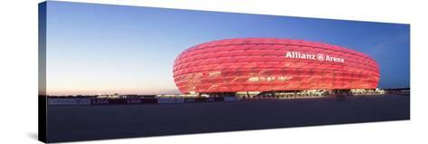 Soccer Stadium Lit Up at Dusk, Allianz Arena, Munich, Bavaria, Germany--Stretched Canvas Print