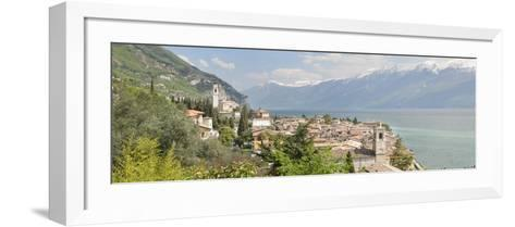 Buildings at the Waterfront with Snowcapped Mountain in the Background, Gargnano, Monte Baldo--Framed Art Print