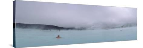 Tourist Swimming in a Thermal Pool, Blue Lagoon, Reykjanes Peninsula, Reykjavik, Iceland--Stretched Canvas Print