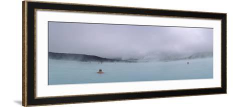 Tourist Swimming in a Thermal Pool, Blue Lagoon, Reykjanes Peninsula, Reykjavik, Iceland--Framed Art Print