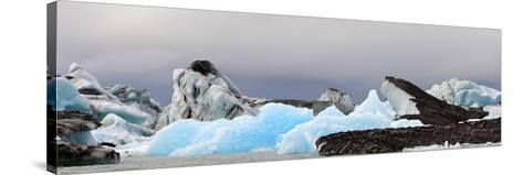 Icebergs and Volcanic Ash, Jokulsarlon Lagoon, Iceland--Stretched Canvas Print