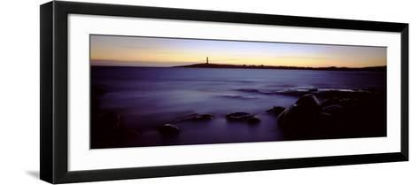 Rock Formations in the Sea with a Lighthouse in the Background, Cape Leeuwin, Western Australia--Framed Art Print