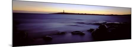 Rock Formations in the Sea with a Lighthouse in the Background, Cape Leeuwin, Western Australia--Mounted Photographic Print