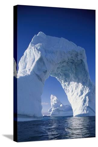 Arch Iceberg Near Lemaire Channel in Antarctica--Stretched Canvas Print