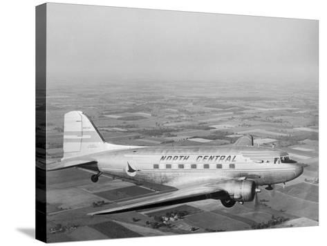 Douglas Dc-3 Plane in Flight--Stretched Canvas Print