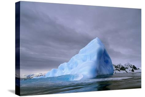 Iceberg at Entrance to Lemaire Channel in Antarctica--Stretched Canvas Print