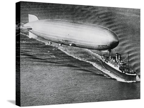 Graf Zeppelin Flying Above the S.S. New York--Stretched Canvas Print