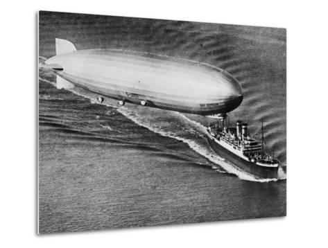 Graf Zeppelin Flying Above the S.S. New York--Metal Print