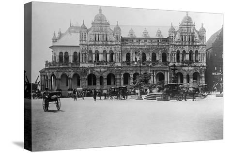 Exterior of Large Bank with Carriages in Front--Stretched Canvas Print