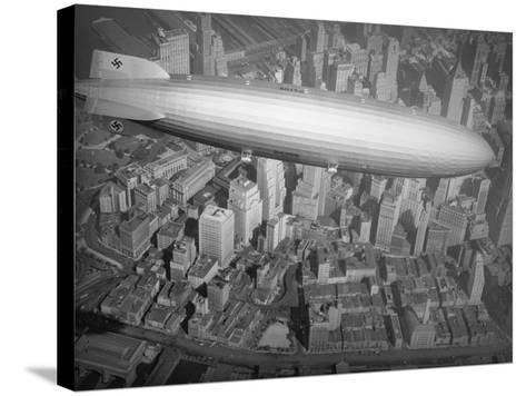 Hindenburg Flying over Manhattan--Stretched Canvas Print
