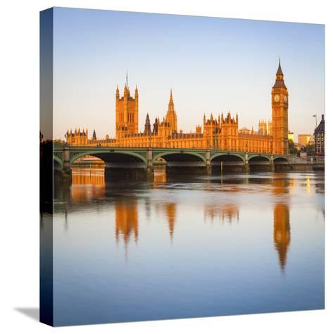 The Houses of Parliament and the River Thames Illuminated at Sunrise.-Doug Pearson-Stretched Canvas Print