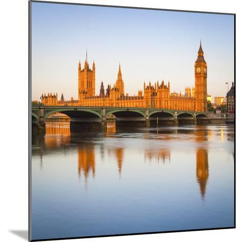 The Houses of Parliament and the River Thames Illuminated at Sunrise.-Doug Pearson-Mounted Photographic Print