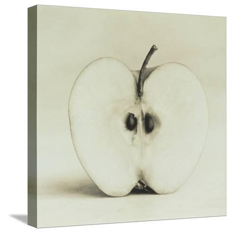 Halved Apple-Graeme Harris-Stretched Canvas Print