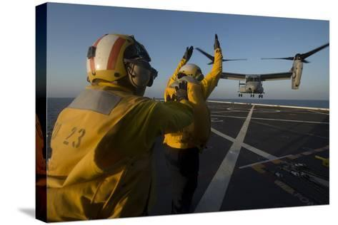 Aviation Boatswain's Mates Direct an MV-22 Osprey on the Flight Deck--Stretched Canvas Print