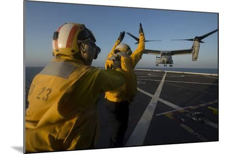 Aviation Boatswain's Mates Direct an MV-22 Osprey on the Flight Deck--Mounted Photographic Print