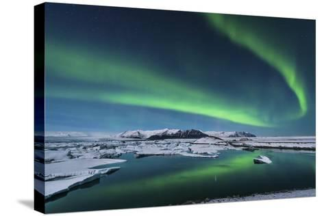 The Northern Lights Dance over the Glacier Lagoon in Iceland--Stretched Canvas Print