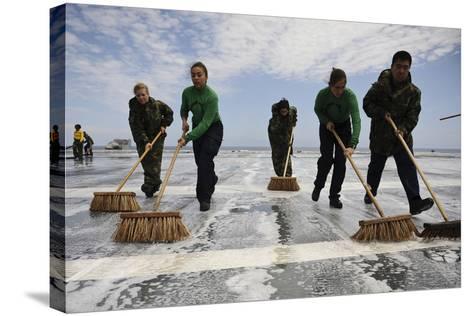 Sailors Scrub the Flight Deck of Aircraft Carrier USS Ronald Reagan--Stretched Canvas Print