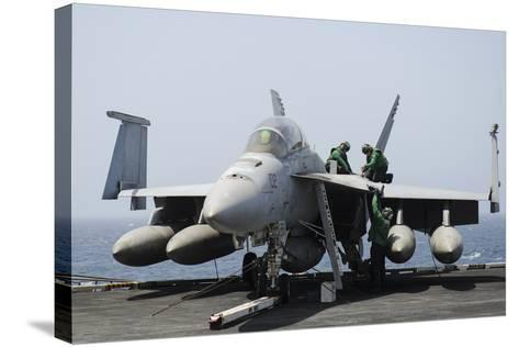 Sailors Perform Maintenance on an F-A-18F Super Hornet--Stretched Canvas Print