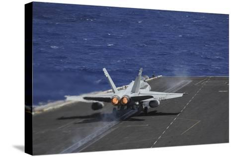 An F-A-18C Hornet Taking Off from USS Dwight D. Eisenhower--Stretched Canvas Print