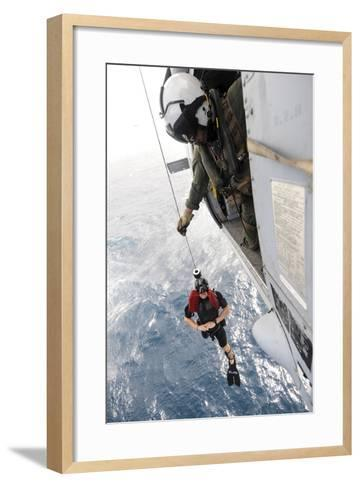Aircrewman Assists in Hoisting a Member into an Mh-60S Sea Hawk--Framed Art Print