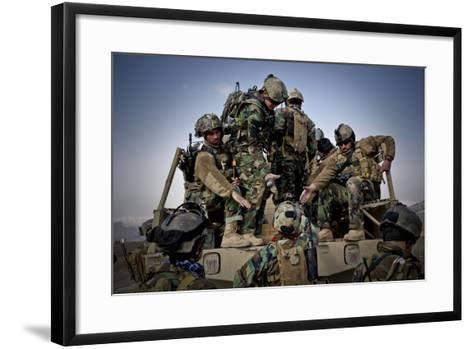 Afghan Soldiers Give a Hand Up to a Fellow Soldier--Framed Art Print