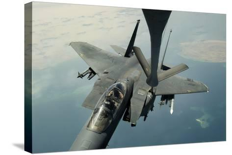 An F-15E Strike Eagle Receives Fuel from a Kc-135R Stratotanker--Stretched Canvas Print