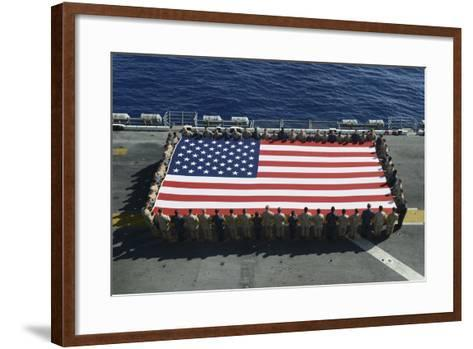 Sailors and Marines Display the National Ensign Aboard USS Kearsarge--Framed Art Print
