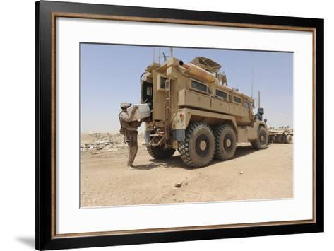 Hospital Corpsman Loads Up a Mine Resistant Ambush Protected Vehicle--Framed Art Print