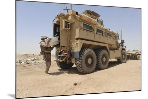 Hospital Corpsman Loads Up a Mine Resistant Ambush Protected Vehicle--Mounted Photographic Print