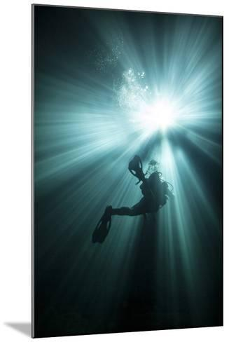 A Scuba Diver Ascends into the Light Emanating Above--Mounted Art Print