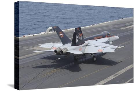 An F-A-18E Super Hornet Lands on the Flight Deck of USS Nimitz--Stretched Canvas Print