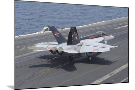 An F-A-18E Super Hornet Lands on the Flight Deck of USS Nimitz--Mounted Photographic Print