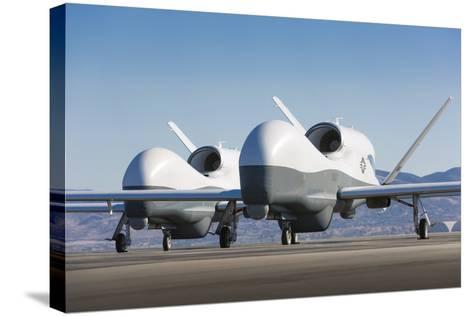Two Mq-4C Triton Unmanned Aerial Vehicles on the Tarmac--Stretched Canvas Print