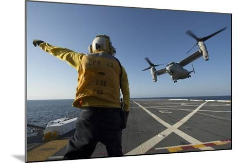 Aviation Boatswain's Mate Directs an MV-22 Osprey as it Launches from the Flight Deck--Mounted Photographic Print