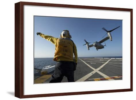 Aviation Boatswain's Mate Directs an MV-22 Osprey as it Launches from the Flight Deck--Framed Art Print