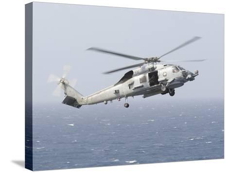 An Mh-60R Sea Hawk Helicopter Prepares to Land--Stretched Canvas Print