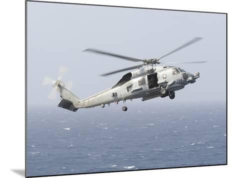 An Mh-60R Sea Hawk Helicopter Prepares to Land--Mounted Photographic Print
