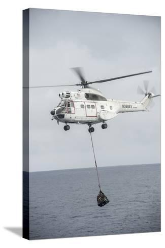 An SA-330 Puma Transport Helicopter Moves Cargo During a Vertical Replenishment--Stretched Canvas Print