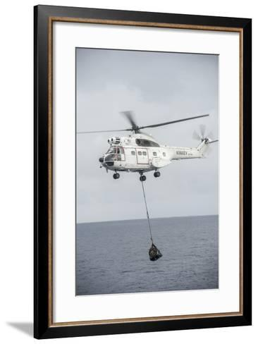 An SA-330 Puma Transport Helicopter Moves Cargo During a Vertical Replenishment--Framed Art Print