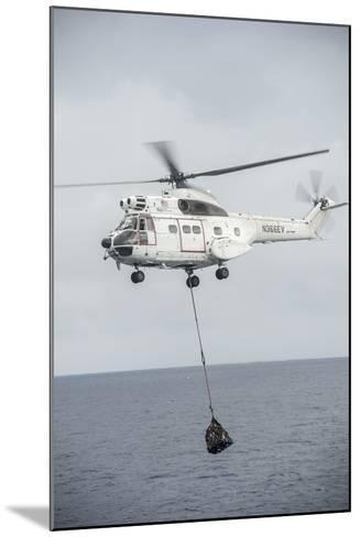 An SA-330 Puma Transport Helicopter Moves Cargo During a Vertical Replenishment--Mounted Photographic Print