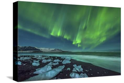 Aurora Borealis over the Ice Beach Near Jokulsarlon, Iceland--Stretched Canvas Print